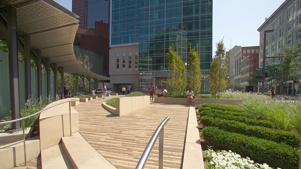 sandstone benches and tan paver under stainless steel canopy at triangle park in pittsburgh